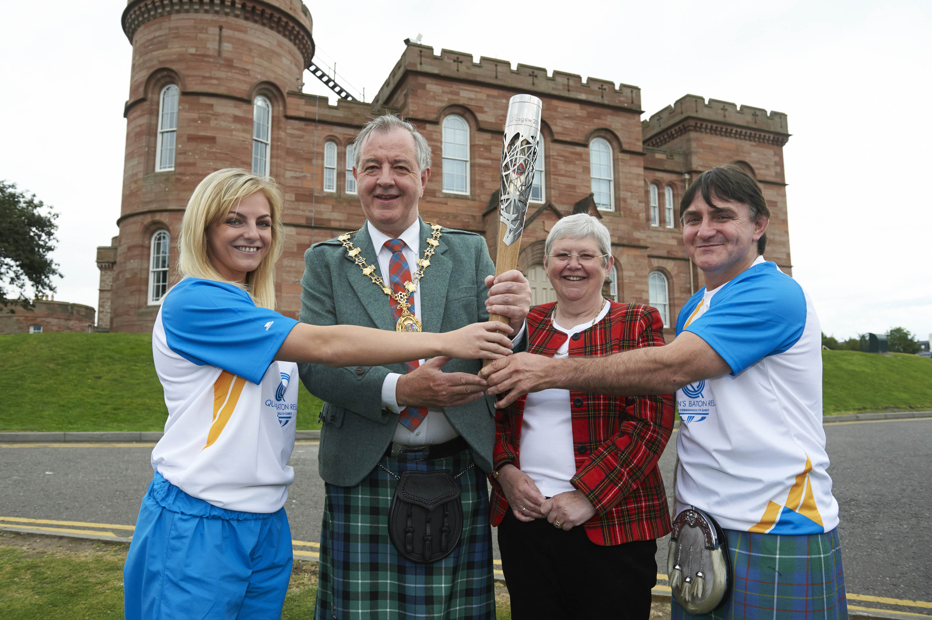 Provost of Inverness with baton bearers at the start of the day