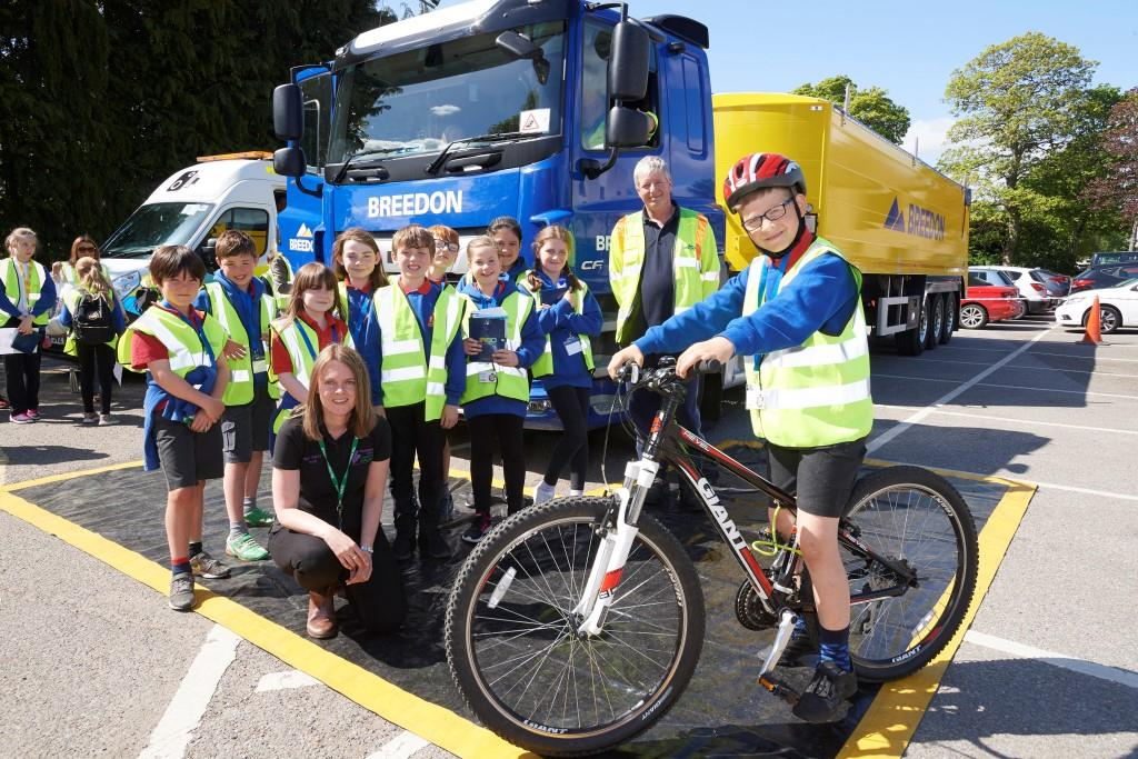 Crown Primary pupils with Szymon Rebilas on bike with Lisa MacKellaich Highland Council Road Safety Officer and John Mackay of Breedon