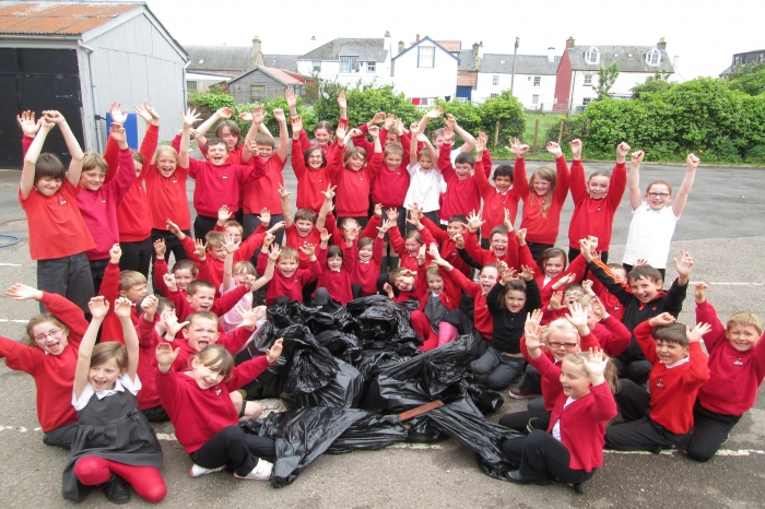 Pupils show all the rubbish they managed to collect from their local beach