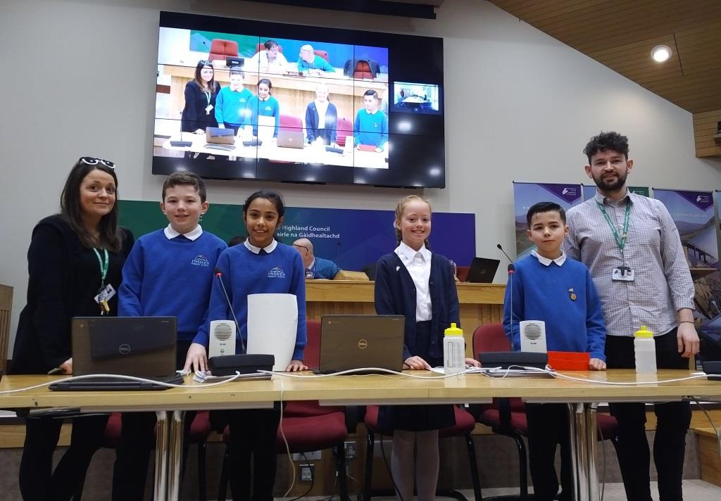 (left to right) Digital Leaders (pupils) from Inshes Primary Riley MacKintosh, Krisha Aryal and Raigmore Primary Anna Watson and Mackenzie Smith with their Teachers – give their presentation to Highland Council.