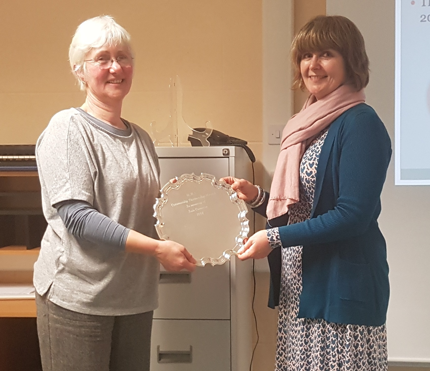 Mrs Wendy Green (left) receives the Iain Cameron Partnership Award from Mrs Louise Cameron.