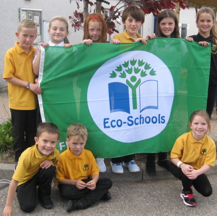 •	Members of last session's Balloch Primary Eco committee with the new Green Flag