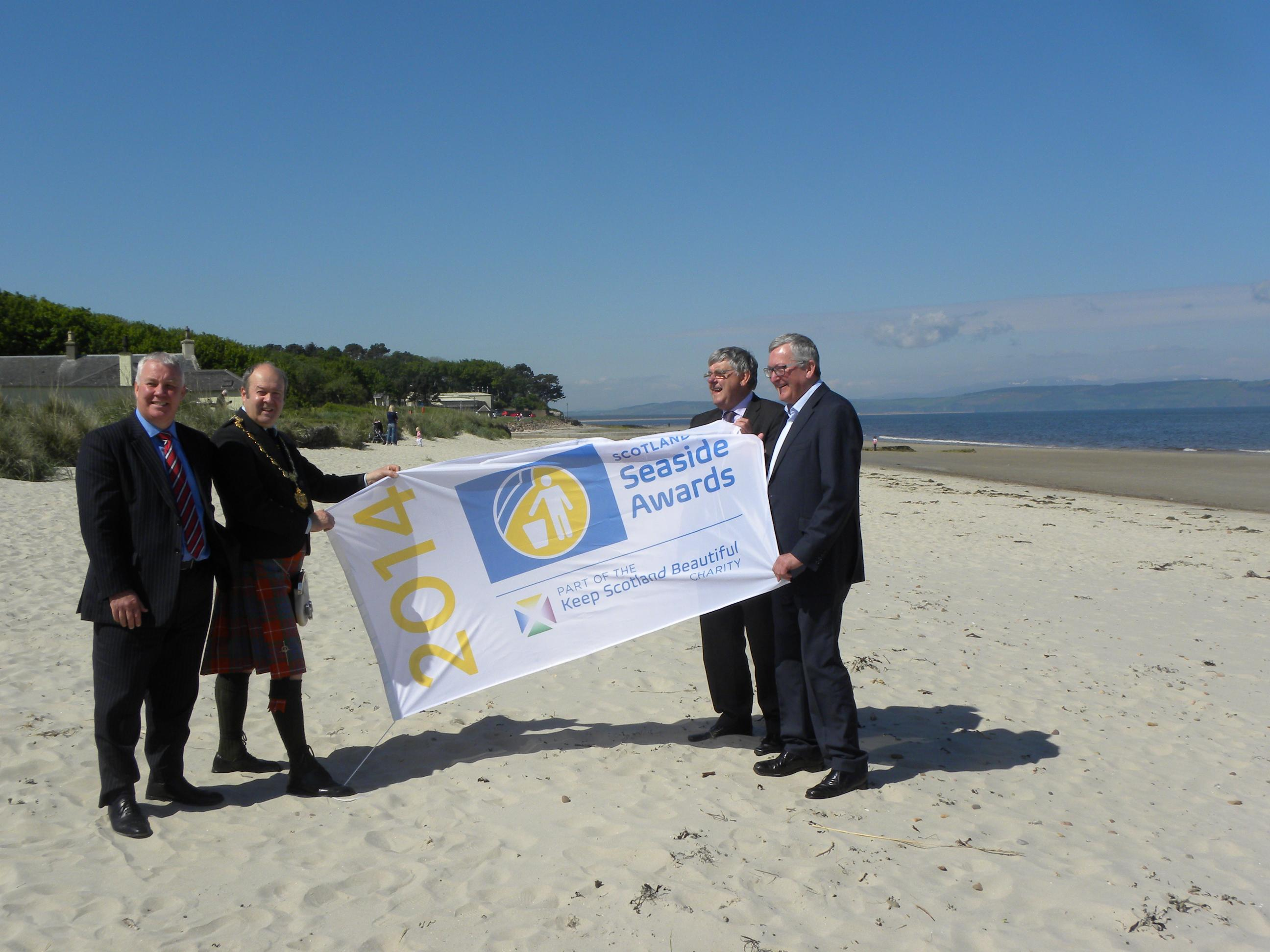 Photo of Derek Robertson, Chief Executive, Keep Scotland Beautiful; Provost of Nairn Laurie Fraser; Councillor Graham MacKenzie, Chairman of Community Services; and Fergus Ewing MSP - Minister for Energy, Enterprise and Tourism