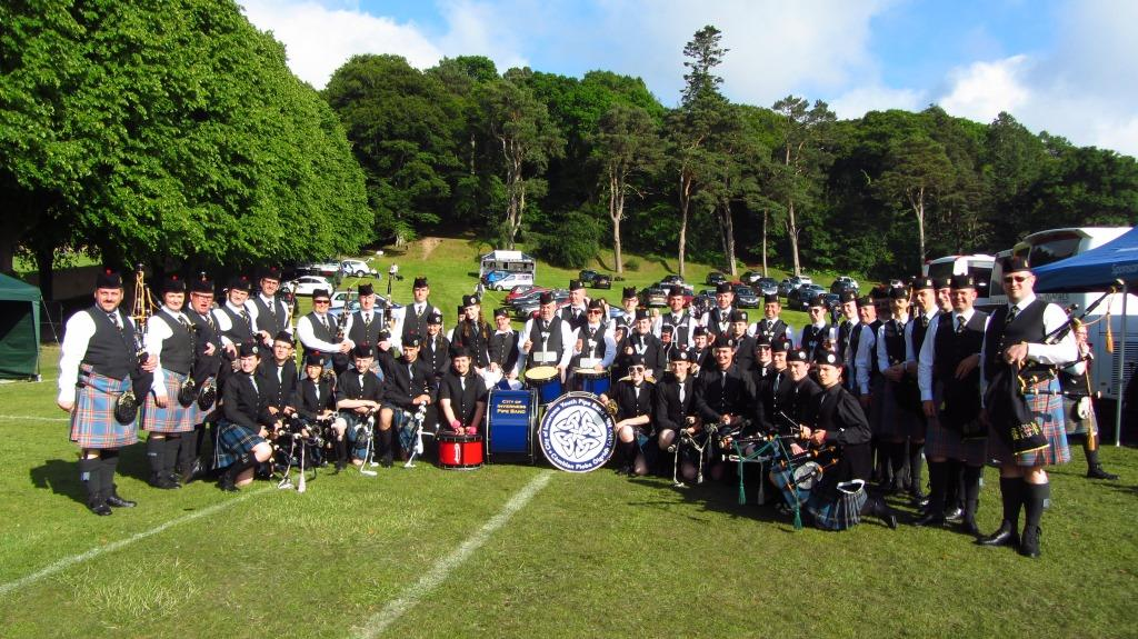 City of Inverness Youth Pipe Band gather with City of Inverness (adult) Pipe Band for the massed bands parade at Forres