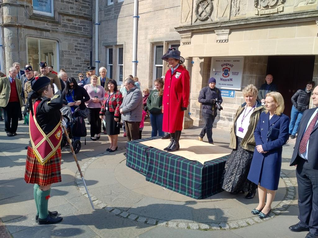 Drum Major Jodie Standen asking Lord Lieutenant Mrs Janet Bowen permission to march the Tri Service Cadet Pipes & Drums off parade outside Dingwall Town Hall.