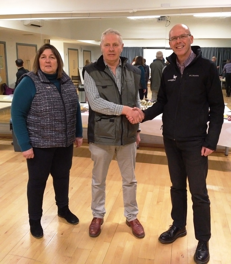 CNPA Director of Communications, David Cameron (right) at the count held in Aviemore congratulates John Kirk elected to Ward 3 with CNPA Board Depute Convener Geva Blackett (left) looking on.