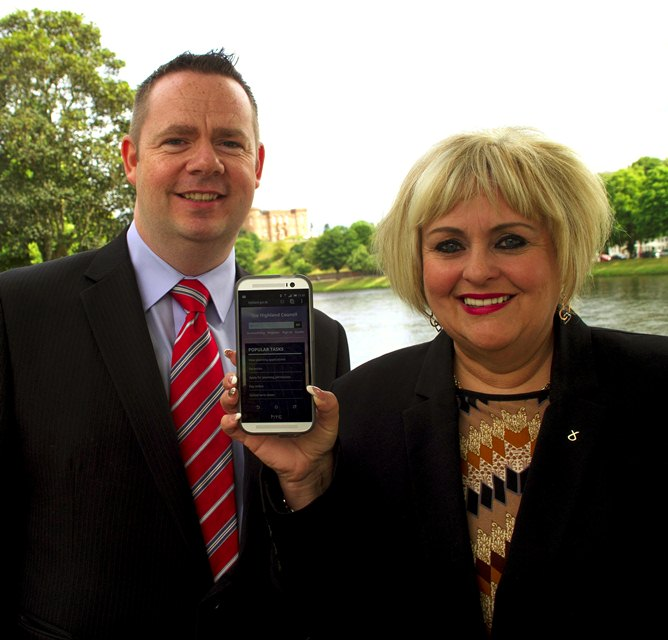 Councillor Maxine Smith, Chair of Resources Committee demonstrates the accessibility of The Highland Council's new website on a smartphone with Darren Macleod, Highland Council's Digital Services Manager.