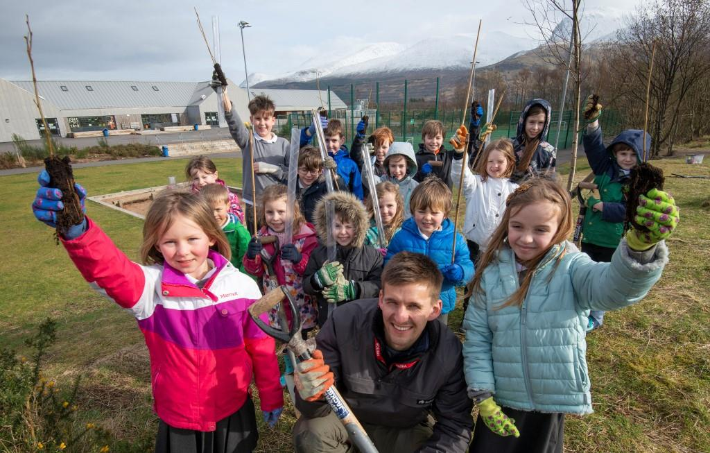Rowan Doff  (centre)  of  Nevis Landscape Partnership  gets ready to plant trees with the children of Bun-Sgoil Ghàidhlig Loch Abar. Picture Iain Ferguson, The Write  Image