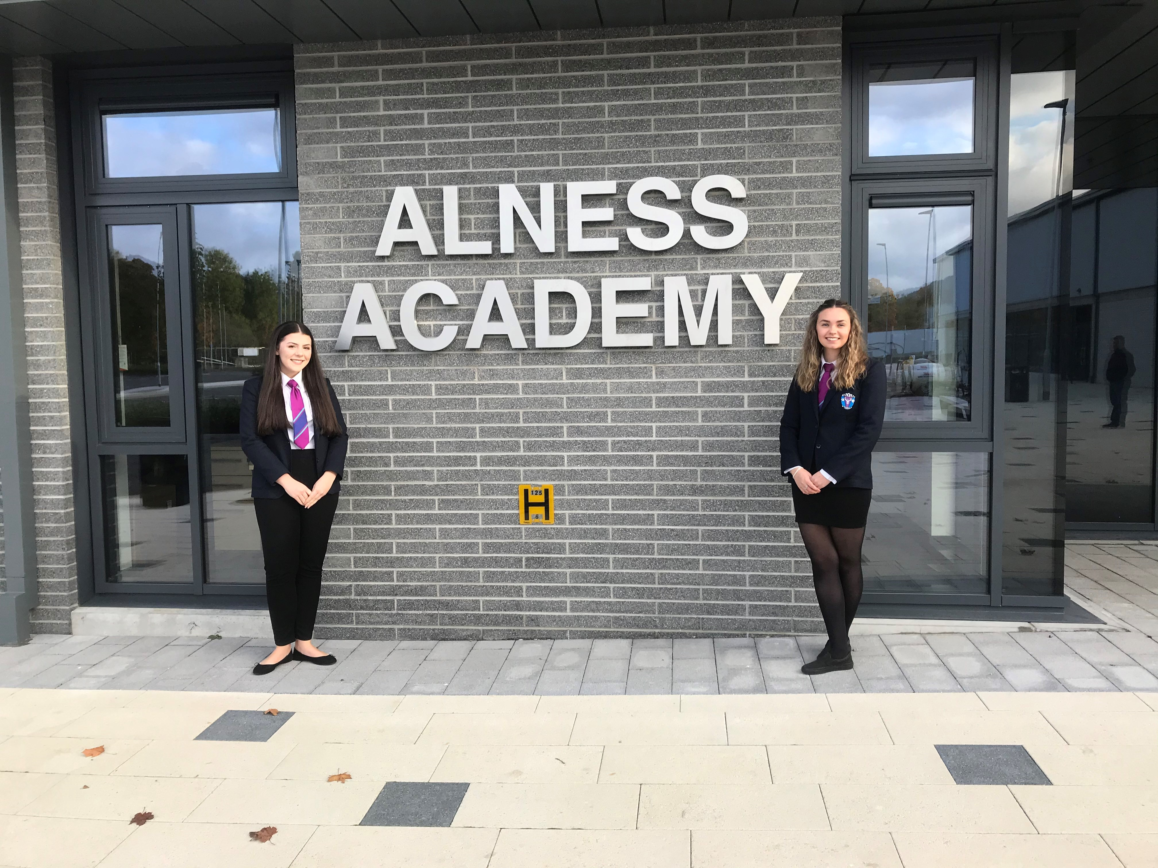 House captains stand next to Alness Academy sign