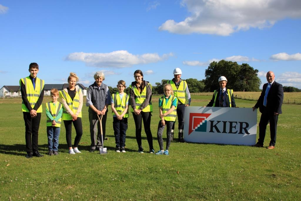 (left to right) Pupils Harley Lea, Rhyce Ashcroft, Nadia McGuinness, Corey Bell, Beth Fergusson, Lily Skinner with Mrs Adrianne Meikle (centre) at the turf cutting.