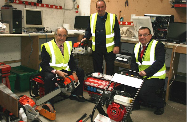 Cllr Thomas Prag, ILM Highland Recycling Operations Manager Kenny Horsefield and Mark McGinty, Trading Standards Team Leader pictured with the tools before they get crushed
